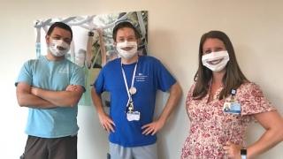 Staff wearing window facemasks