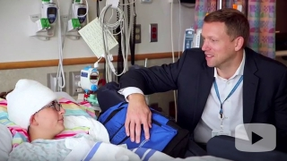 Dr. Kennedy sitting with patient in hospital room
