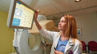 Radiology professional adjusting equipment