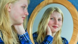 Girl smiling in mirror