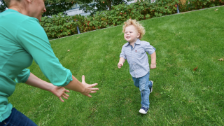 young boy IBD patient running to mom's arms