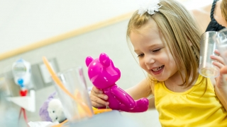 smiling child playing with toys