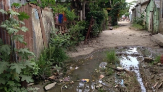 Standing water and trash in a lower socio-economic neighborhood in Consuelo - a community that fellows like Dr. Turner help care for.