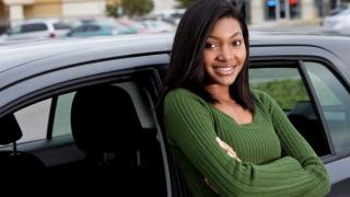 teen girl leaning against car