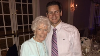 Tommy CF patient standing with his Grandmother smiling