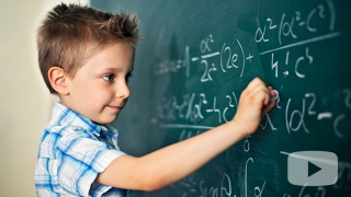 Young boy using chalkboard