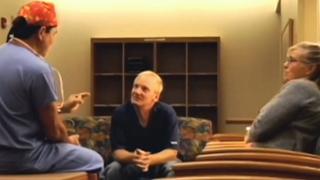 surgeon talking to parents