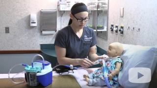 Nurse demonstrating how to use inline catheter