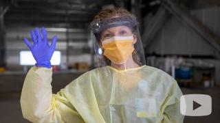 Screen grab of worker in PPE