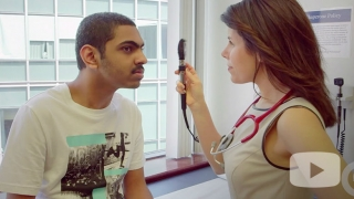 Dr. Waldman examining patient's eyes