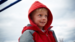 boy wearing jacket with hood