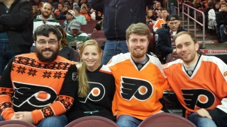 Zane with his siblings at a flyers game