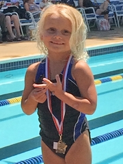 kendall showing swimming medal