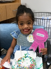 Lilly holding her birthday cake