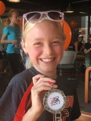 Andrea holding her race medal