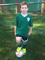 Jacob smiling in his soccer uniform
