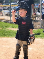 Cardiac patient in catcher uniform at baseball game