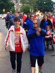 John Rosati of New Jersey carries the torch for part of the Special Olympics Unified Relay Across America