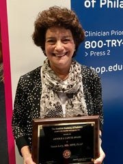 Susan Levy honored with the Arnold J. Capute Award