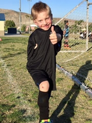 Tayvin on soccer field giving thumbs up
