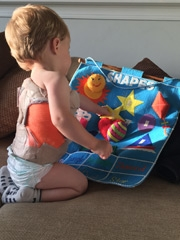 Tristan wearing back brace playing with toys