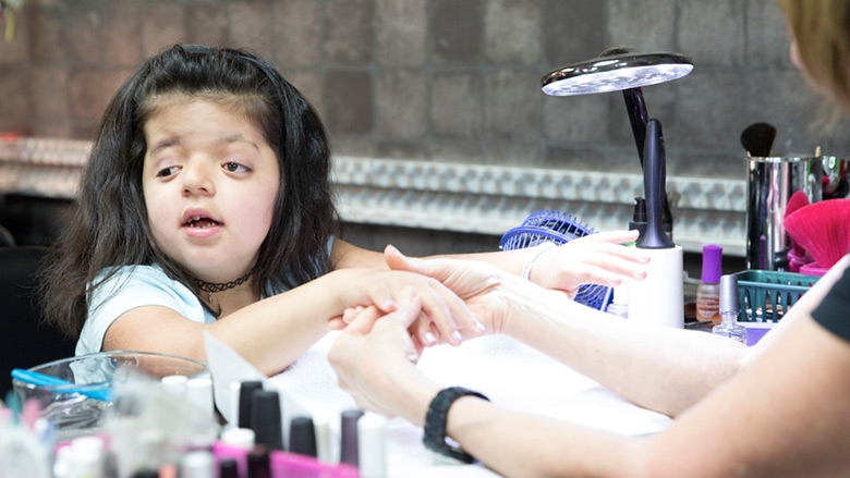 Young girl getting her nails done