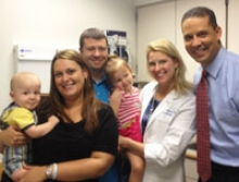 The Woodruff family with Dr. Hedrick and FOX 29 reporter Iain Page.