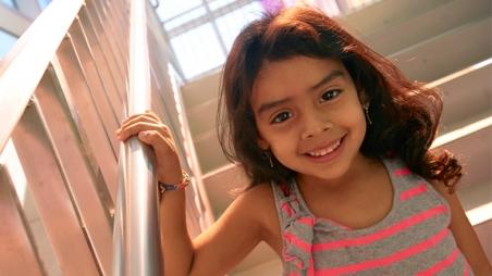 Girl smiling walking down stairs
