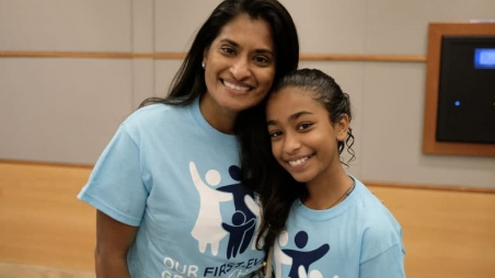 Mother and daughter at event in matching shirts