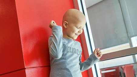 Young cancer patient laughing