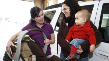 mother and child with safety seat