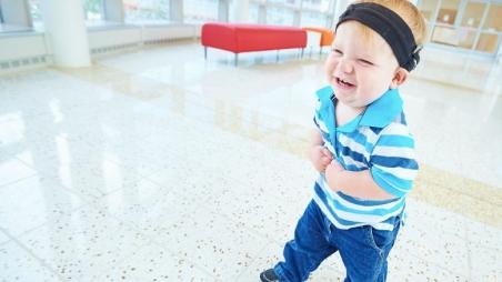 Boy hospital patient walking in hallway smiling