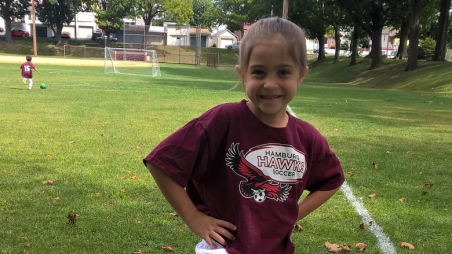 Elise smiling on soccer field