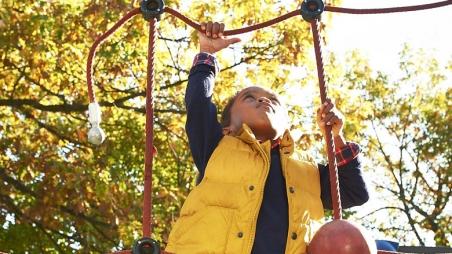 Boy climbing on outdoor playground