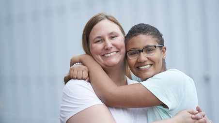 Oncology teen patient hugging her mother