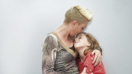 Mother hugging daugther