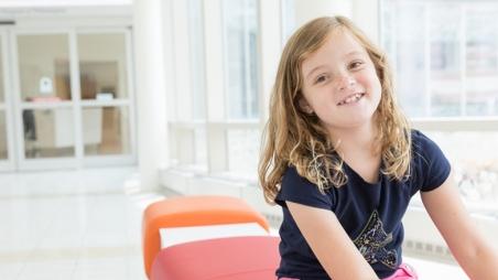 Hannah sitting and smiling