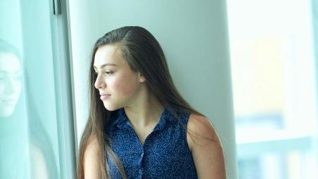Teen girl looking sad