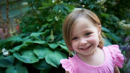 Olivia smiling outside