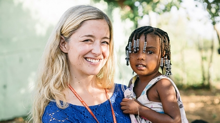 Maria Dunn with a child