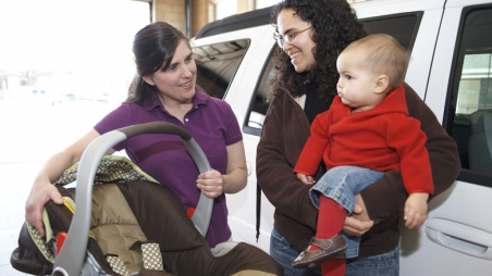 Mom with baby and car seat instructor