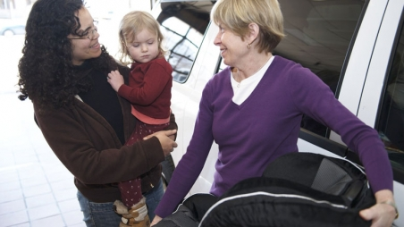 Mom with toddler and car seat instructor