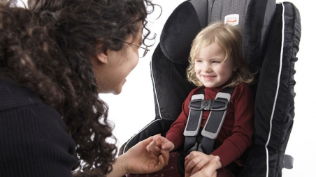 Mom with toddler in front facing car seat