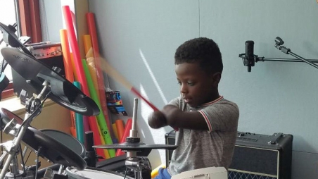 Chase playing the drums