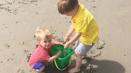 Tristan at the beach with his brother playing in the sand