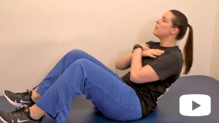 Woman performing sit-up exercise