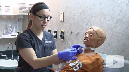 Nurse demonstrating how to use straight catheter
