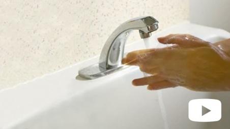Hands washing in sink