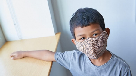 Young boy wearing protective mask