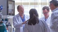Fetal doctors talking in lab